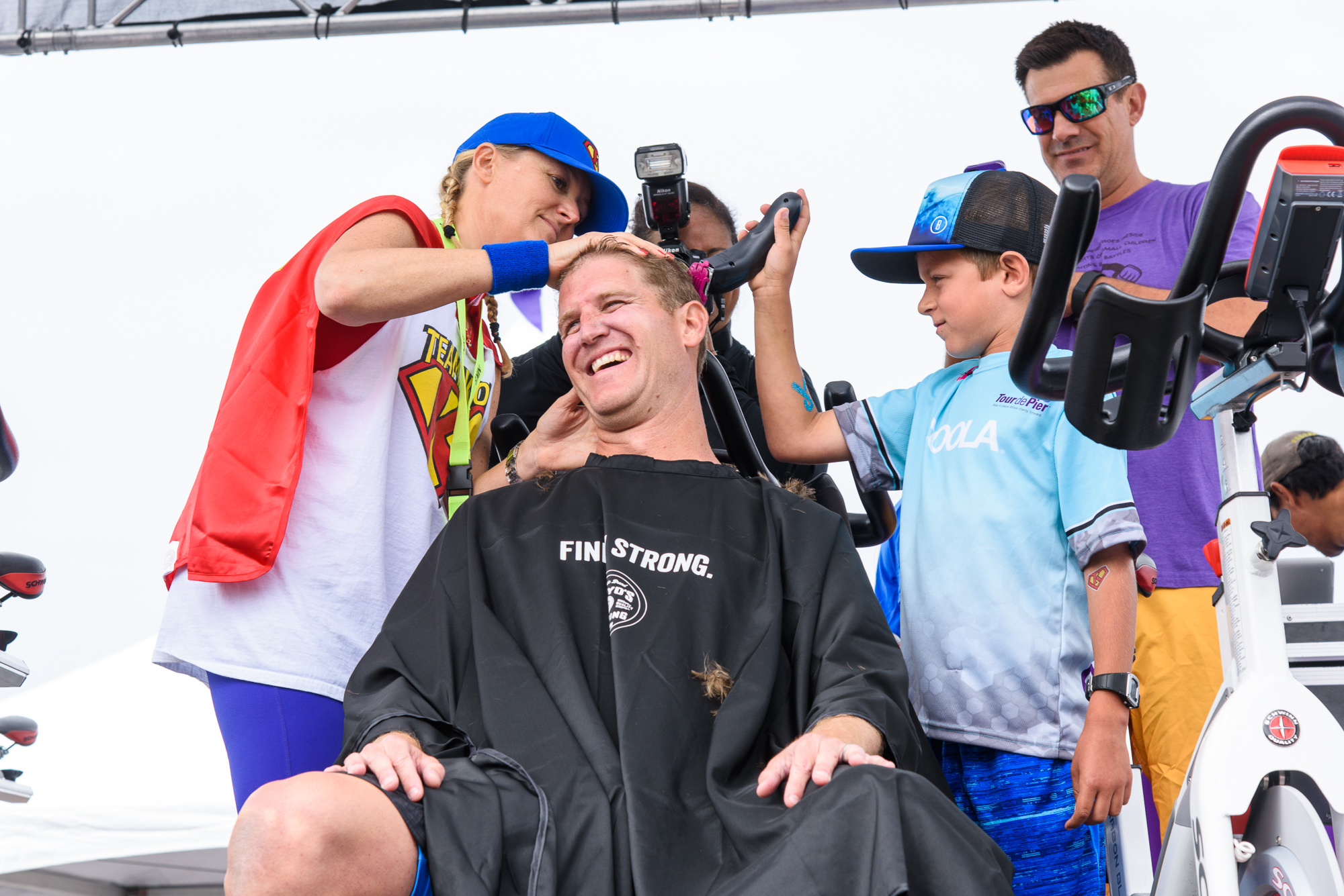 Chinny helping to shave co-founder Heath's head to celebrate breaking $1 million fundraised in 2016!